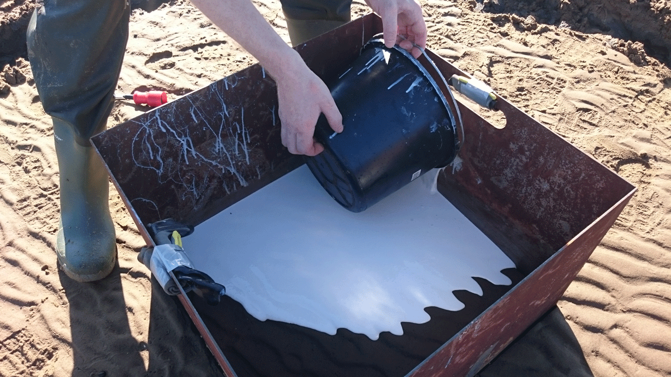 Silicone mold being poured on ocean floor