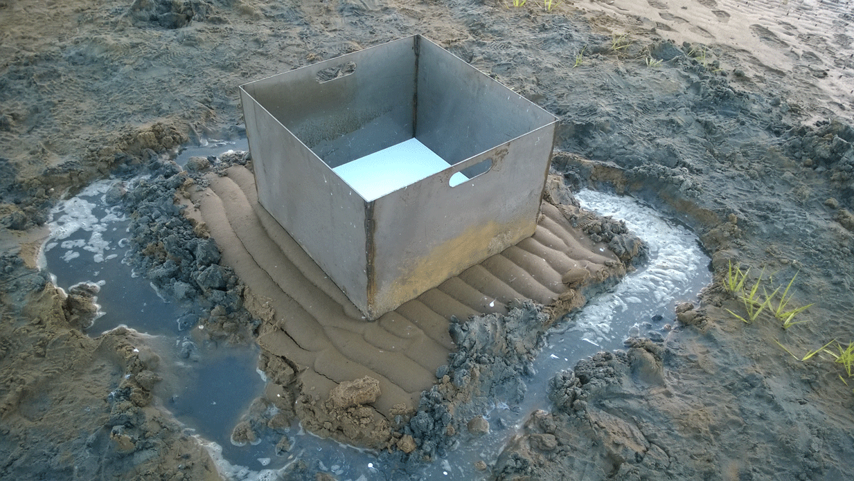 Silicone mold curing on ocean floor in mold box