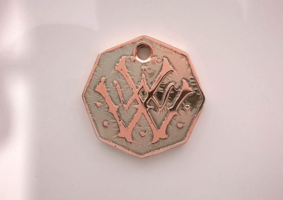 Finished electro-etched and plated piece